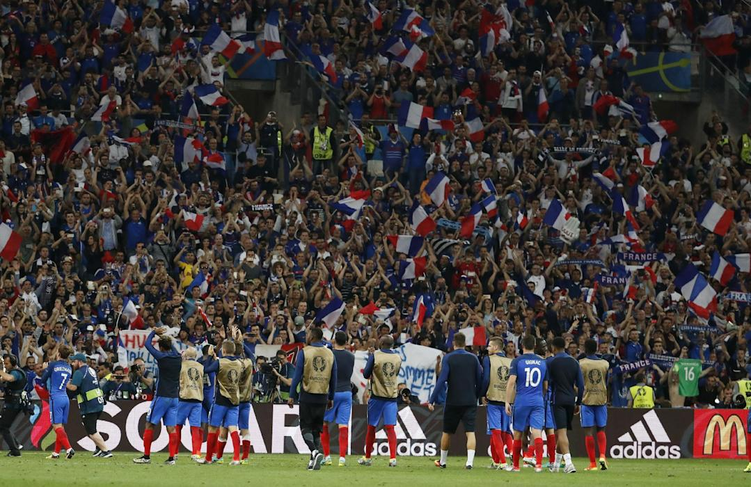 France players and fans celebrate at the end of the match