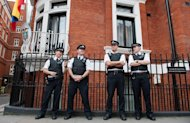 Police stand outside the Ecuadorian Embassy in London on August 19, 2012. A hidden microphone was found in Ecuador's embassy in London, where WikiLeaks founder Julian Assange is holed up, Ecuador's foreign minister said