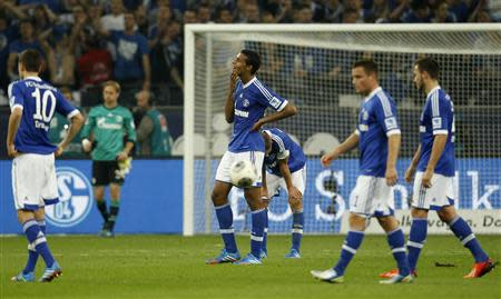 Schalke 04' s players react during the German first division Bundesliga soccer match against against Bayern Munich in Gelsenkirchen