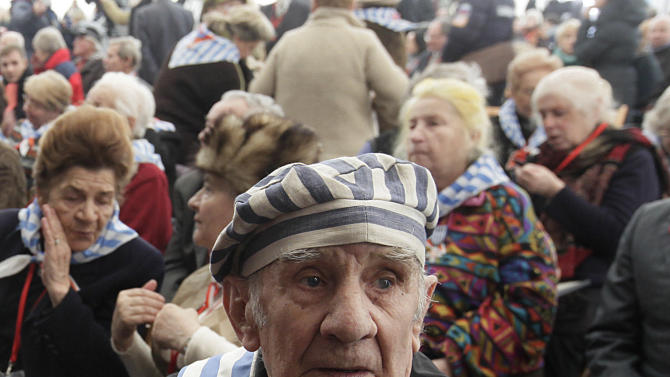 Former prisoner Miroslaw Celka, 89, attends a ceremony at  the Auschwitz concentration camp  in Oswiecim, Poland, Sunday, Jan. 27, 2013,  marking the 68th anniversary of the liberation of Auschwitz by Soviet troops and  remembering  the victims of the Holocaust, in Auschwitz-Birkenau.  (AP Photo/Czarek Sokolowski)