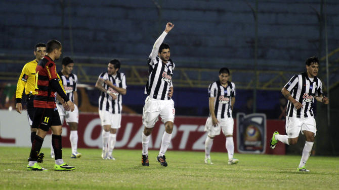Pedro Benitez of Paraguay's Libertad celebrates with teammates after scoring against Brazil's Sport Recife during their Copa Sudamericana match in Luque