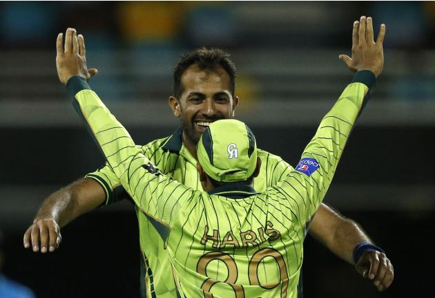 Pakistan's Wahab Riaz celebrates with team mate Haris Sohail after dismissing Zimbabwe's Craig Ervine for 14 runs during their Cricket World Cup match at the Gabba in Brisbane