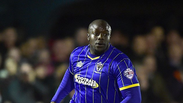 Adebayo Akinfenwa scored twice and missed a penalty in AFC Wimbledon's victory