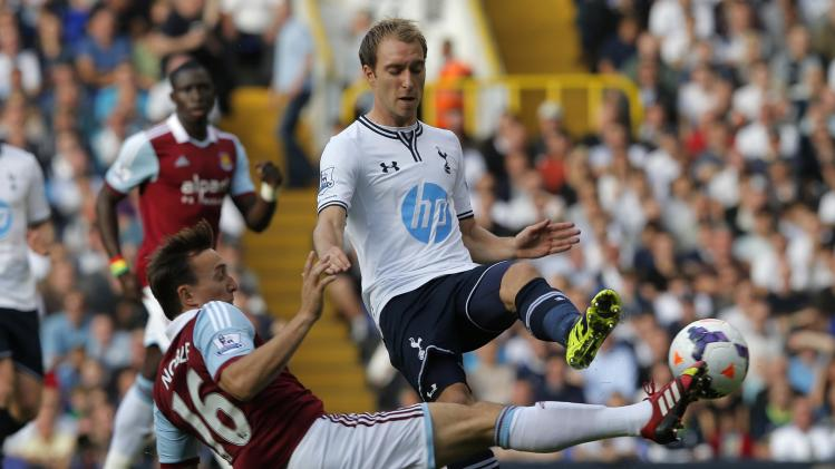 Tottenham Hotspur's Eriksen challenges West Ham United's Noble during their English Premier League soccer match in London