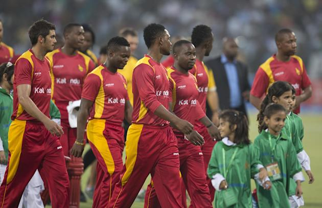 Zimbabwean cricket players enter the ground to play against Pakistan at the Gaddafi stadium in Lahore, Pakistan, Friday, May 22, 2015. Zimbabwe is the first test playing nation to visit Pakistan in mo