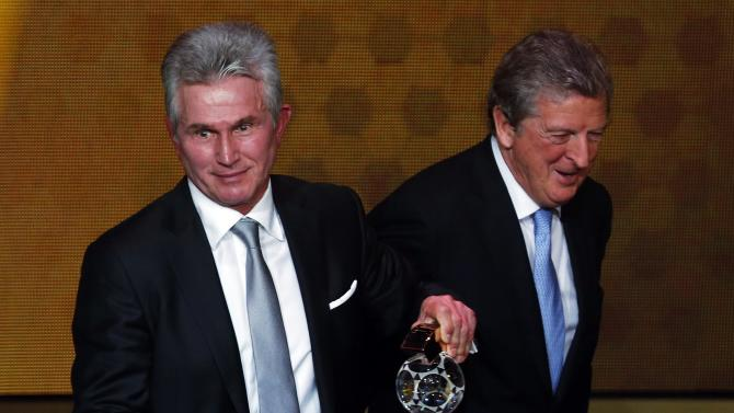 Former Bayern Munich coach Jupp Heynckes holds his trophy after winning the FIFA Coach of the Year award alongside England manager Roy Hodgson during the FIFA Ballon d'Or soccer awards ceremony in Zurich
