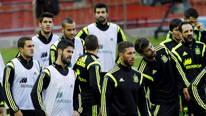 Spanish national soccer team players attend a training session ahead of their Euro 2016 qualifier against Ukraine in the Andalusian capital of Seville,