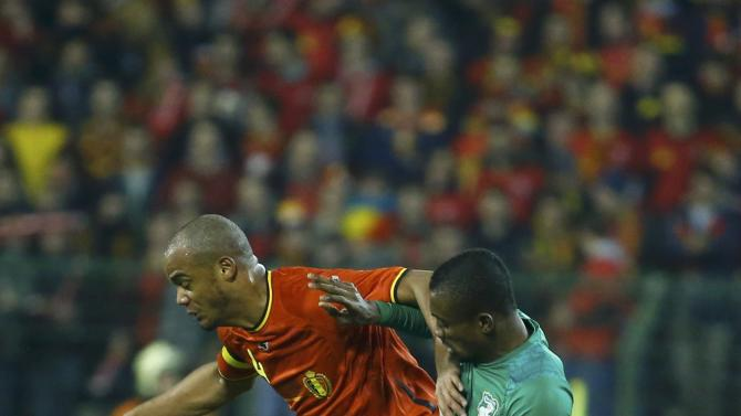 Belgium's Kompany and Ivory Coast's Kalou battle for the ball during their international friendly soccer match at King Baudouin Stadium in Brussels