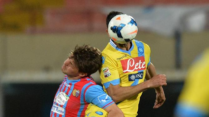 Catania forward Bruno Petkovic, left, of Croatia, jumps for the ball with Napoli defender Miguel Angel Britos, of Uruguay, during a Serie A soccer match between Catania and Napoli at the Angelo Massimino stadium in Catania, Italy, Wednesday, March 26, 2014