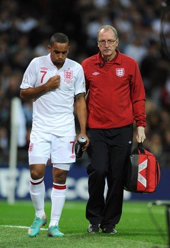 Theo Walcott, left, has been ruled out of England's clash with Poland