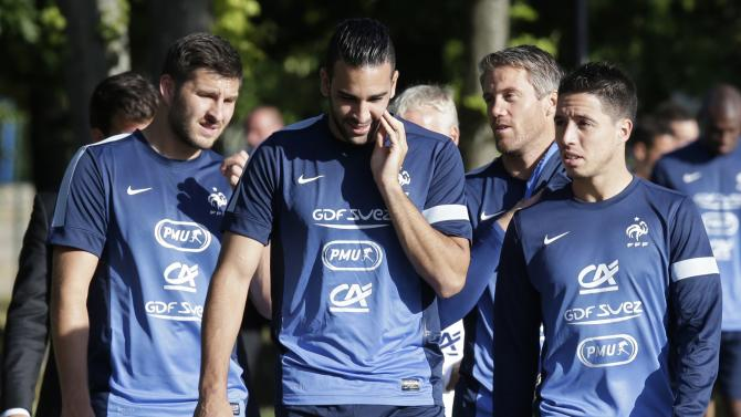 France's national soccer team players Andre-Pierre Gignac, Adil Rami and Samir Nasri arrive training session in Clairefontaine