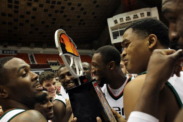Miami celebrates after capturing last year's Puerto Rico Tip-Off (AP)