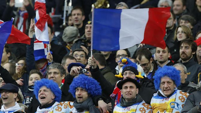 French supporters cheer during the the French National anthem prior to a Six Nations international rugby union match between France and England at Stade de France stadium in Saint Denis, near Paris, Saturday, Feb. 1, 2014. France won against England 26-24