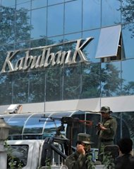 File photo of Afghan security guards keeping watch outside the main branch of the Kabul Bank, in Kabul. The near-collapse in 2010 of the Kabul Bank, the country's biggest private lender responsible for paying 80 percent of government employees came to symbolise the extent of the country's graft problem