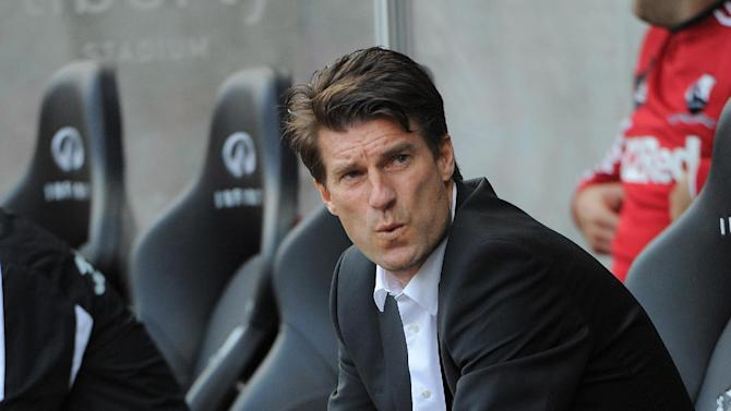 Michael Laudrup will head to Anfield for the first time in his career