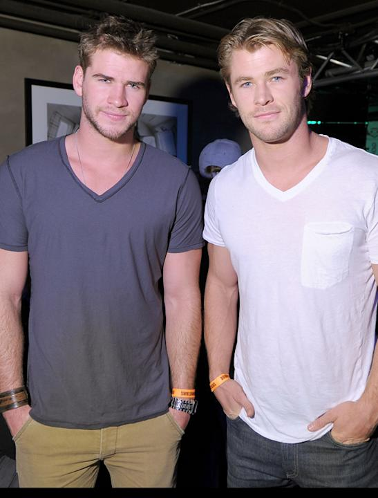Chris Hemsworth and Liam Hemsworth photos: Loving the v-necks guys! Copyright [Getty]