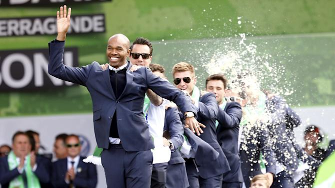 VFL Wolfsburg's Naldo leads the team during celebrations after winning the German soccer Cup in Wolfsburg