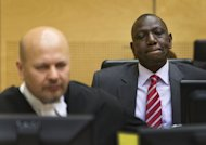 Kenya's Vice President William Ruto (R) sits in the courtroom before the start of his trial at the International Criminal Court (ICC) in The Hague on September 10, 2013