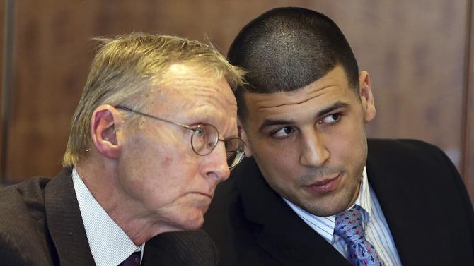 Aaron Hernandez chats with his lawyer Charles Rankin as he appears for a pre-trial hearing at Bristol County Superior Court in Fall River