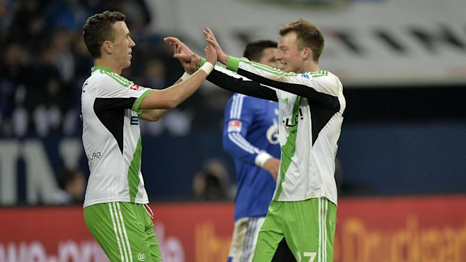 Wolfsburg's Maximilian Arnold, right, celebrates his goal with Wolfsburg's Ivan Perisic of Croatia during the German Bundesliga soccer match between FC Schalke 04 and VfL Wolfsburg in Gelsenkirchen,  Germany, Saturday, Feb. 1, 2014