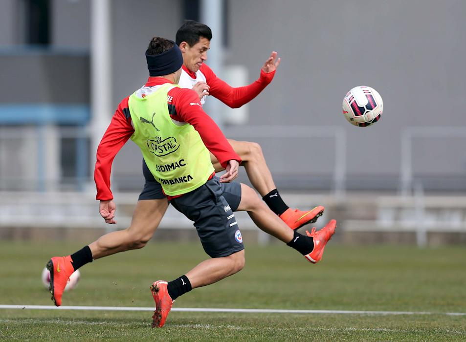 Chile's national soccer players Alexis Sanchez and Eugenio Mena fight for the ball during a training session at St. Polten