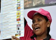 An East Timor parliamentary election official holds up a ballot paper during the counting proces in Dili, on July 7. E.Timor Prime Minister Xanana Gusmao's party looks set to win this weekend's parliamentary elections, according to preliminary results published on Sunday