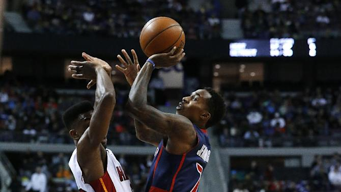 Detroit Pistons point guard Brandon Jennings (7) is fouled by Miami Heat point guard Norris Cole (30) in the second quarter of an NBA basketball game in Auburn Hills, Mich., Sunday, Dec. 8, 2013