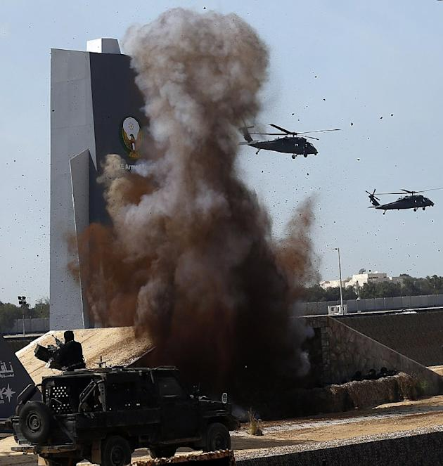 Helicopters perform during a military show launching the International Defence Exhibition and Conference (IDEX) at the Abu Dhabi National Exhibition Centre in the Emirati capital on February 17, 2013.
