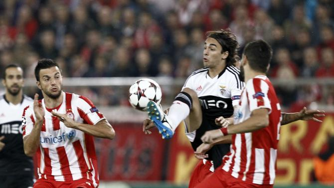 Benfica's Markovic jumps for the ball during Champions League soccer match against Olympiakos in Piraeus near Athens