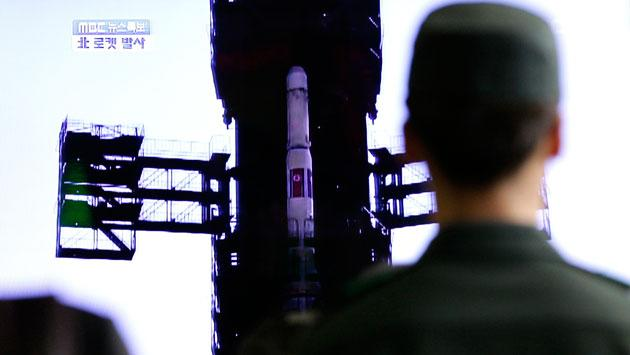 South Korean soldier watches a TV news reporting about North Korea's long-range rocket at Seoul train station in Seoul, South Korea, Friday, April 13, 2012. North Korea fired a long-range rocket early