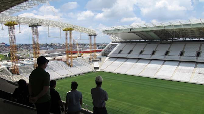 People look out at the pitch during a tour of the Arena Sao Paulo stadium in Sao Paulo