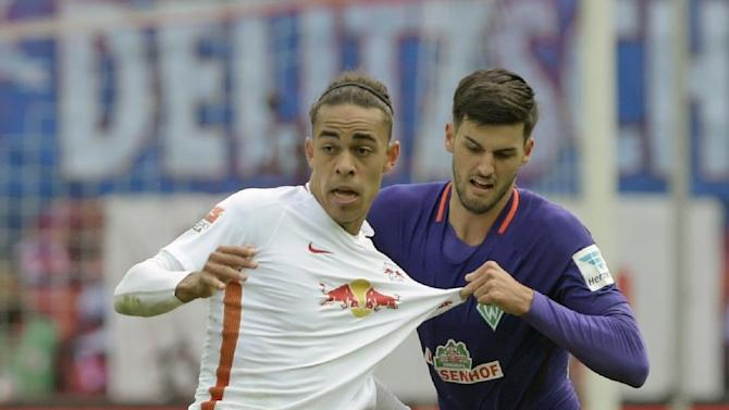 FILE - In this Oct. 23, 2016 file picture Leipzig's Yussuf Poulsen, left, challenges for the ball against with  Bremen's Florian Grillitsch, right, during the German first division Bundesliga soccer match between RB Leipzig and SV Werder Bremen in Leipzig, Germany. Founded in 2009, Leipzig leads the Bundesliga by three points from powerhouse Bayern Munich after a record 13-game unbeaten start including eight wins from its last eight games.  (AP Photo/Jens Meyer,file)