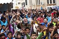 Syrian anti-government demonstrators shout slogans during a protest in Atareb in the northwestern province of Idlib
