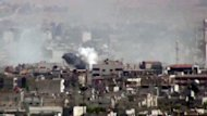 An image grab taken from a video uploaded on YouTube on August 13,allegedly shows smoke billowing from shelling on the Damascus district of al-Qadam as Syrian government forces bombarded rebel strongholds around the capital and rounded up residents in a massive raid in the heart of the the city, according to opposition activists