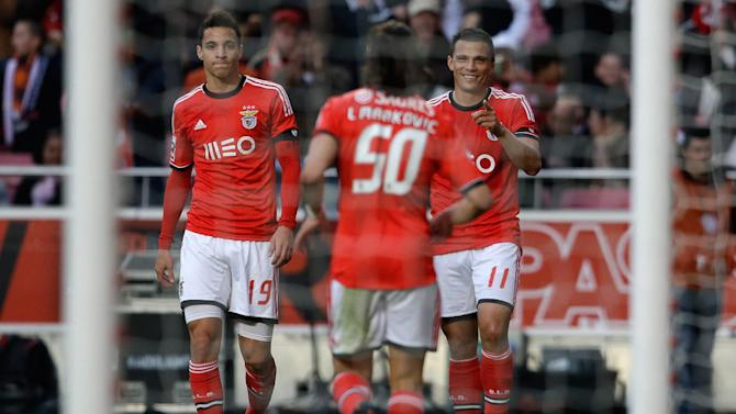 Benfica's Lima, from Brazil,  right, celebrates with Lazar Markovic, from Serbia, center, and Rodrigo, from Spain, after scoring his second goal during their Portuguese league soccer match with Academica Sunday, March 23 2014, at Benfica's Luz stadium in Lisbon