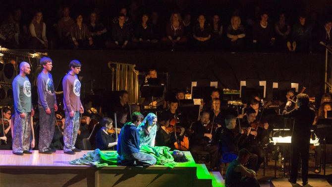 "In this photo provided by Lincoln Center for the Performing Arts, the cast and orchestra is seen together during Act 1, Scene 3, ""Lazarus"" during a performance of ""The Gospel According to the Other Mary"" at Avery Fisher Hall at New York's at Lincoln Center, Wednesday, March 27, 2013. (AP Photo/Lincoln Center for the Performing Arts, Richard Termine)"