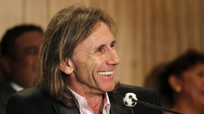 Argentina's Ricardo Gareca smiles during his presentation to the media as the new national soccer head coach of Peru in Lima