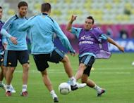 """File photo shows Spanish midfielder Santi Cazorla (R) during a team training session in June. Manager Arsene Wenger on Saturday denied speculation that Arsenal were about to buy Cazorla, saying the club were """"not close to signing anybody"""""""