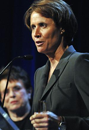 FILE - In this June 18, 2007, file photo, Mary Carillo accepts the Gracie Award for Outstanding Program Host as tennis great Billie Jean King watches at left during the Gracie Allen Awards gala in New York. Sports purists may grumble, but the slice of life features about Olympic host countries provided by Carillo and Jimmy Roberts are usually a welcome diversion in NBC's coverage. Between the events and the apparent need to showcase Ryan Seacrest, they've been mostly missing from London, although NBC promises that will change during the second week. (AP Photo/Louis Lanzano, File)