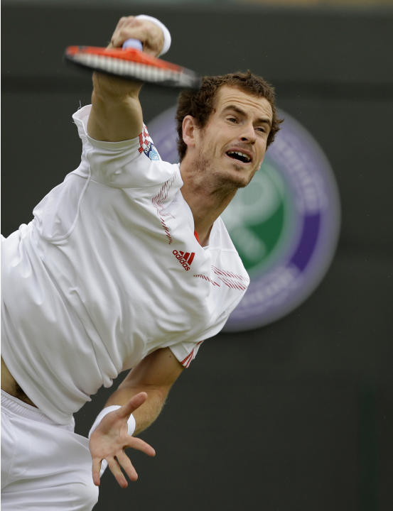 Andy Murray of Britain serves to Marin Cilic of Croatia during a fourth round singles match at the All England Lawn Tennis Championships at Wimbledon, England, Tuesday, July 3, 2012. (AP Photo/Kirsty
