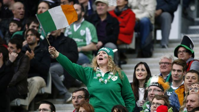 Supporters cheer Ireland's players during their Six Nations rugby union match against France at the Stade de France in Saint-Denis, near Paris