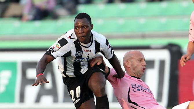 Udinese's midfielder Kwadwo Asamoah of Ghana, left, and Palermo's midfielder Giulio Migliaccio challenge for the ball during their Serie A soccer match at the Friuli stadium in Udine, Italy, Sunday, Oct. 30, 2011. (AP Photo/Paolo Giovannini)