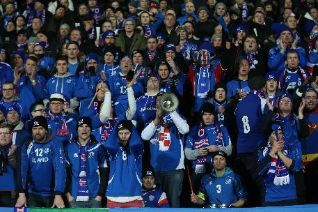 Iceland supporters react during their team match against Croatia, during their World Cup qualifying payoff soccer match in Reykjavik, Iceland,  Friday Nov. 15, 2013