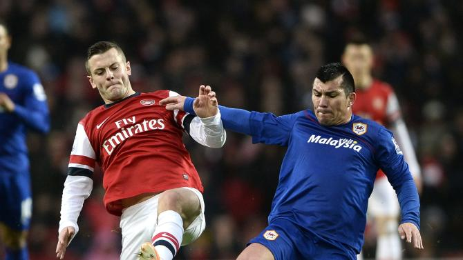 Arsenal's Wilshere challenges Cardiff City's Medel during their English Premier League soccer match in London