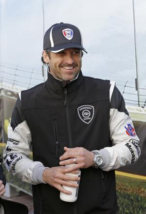 Driver Patrick Dempsey laughs with other drivers in the Fanzone area during an autograph session prior to the start of the IMSA Series Rolex 24 hour auto race at Daytona International Speedway in Daytona Beach, Fla., Saturday, Jan. 25, 2014. (AP Photo/John Raoux)