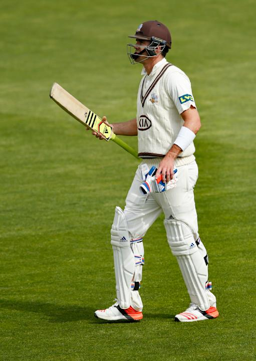 Cricket: Surrey's Kevin Pietersen looks dejected after he was dismissed
