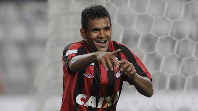 Ederson of Brazil's Atletico Paranaense celebrates after scoring against Peru's Sporting Cristal during a Copa Libertadores soccer match in Lima, Peru, Wednesday, Jan. 29, 2014