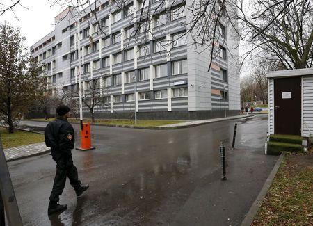 A security guard walks near a building, which houses a laboratory accredited by WADA, in Moscow