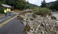Boulder County road workers walk down the flood-destroyed Main Street in Jamestown, Colorado, after a flash flood destroyed much of the town, September 14, 2013. REUTERS/Rick Wilking