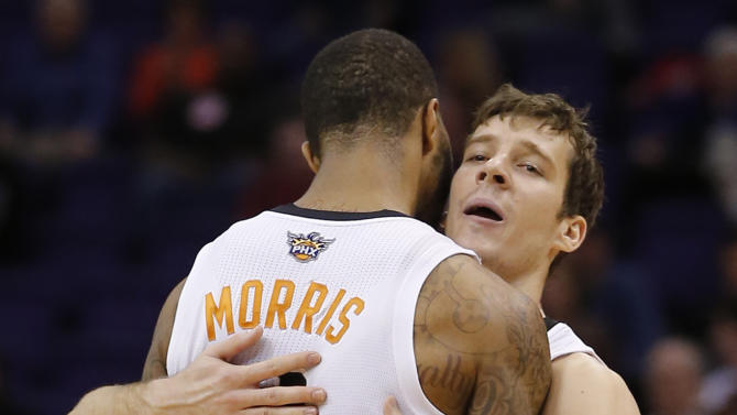 Phoenix Suns' Goran Dragic, of Slovenia, embraces teammate Markieff Morris (11) during the second half of an NBA basketball game, Wednesday, Nov. 27, 2013, in Phoenix. The Suns won 120-106